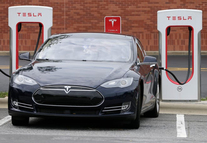 A Tesla electric car charging on July 7, 2017, in Charlotte, North Carolina.