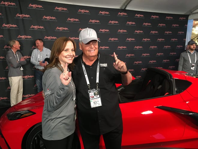GM CEO Mary Barra and Corvette collector Rick Hendrick at the auction block where Hendrick paid $3 million for VIN #0001 of the first mid-engine Corvette.