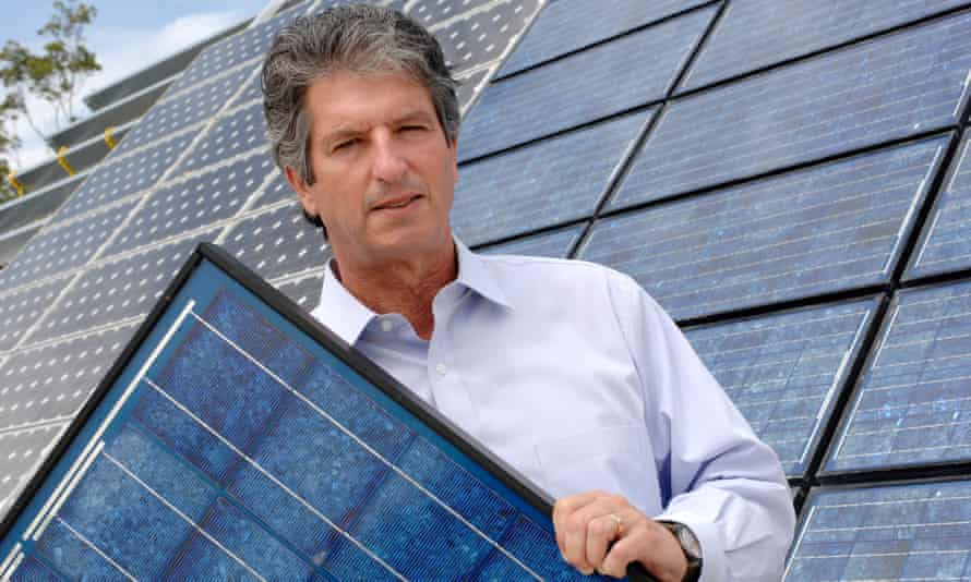 University of NSW solar photovoltaic researcher Martin Green holds a solar panel