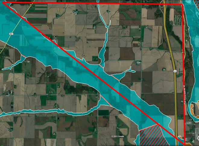 The Johnson County Solar Triangle, outlined in red, was chosen because it was undeveloped land near important interface points with Iowa City's electrical grid. The teal blue area in this map shows the floodplain for both the Iowa and Old Man's rivers.