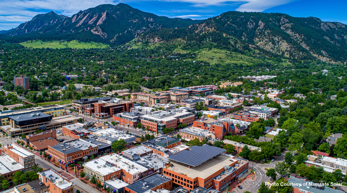 Arial view of Boulder with shot of solar panels