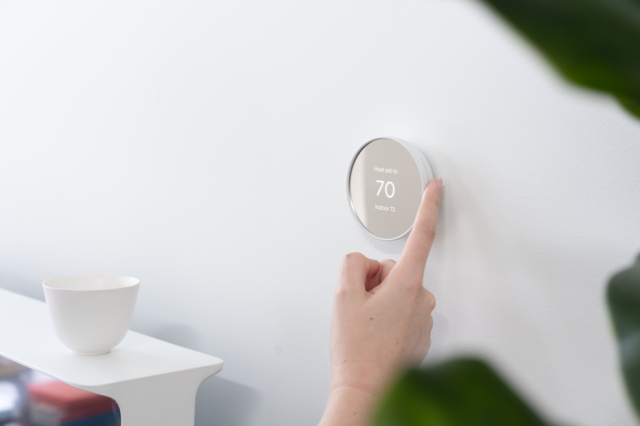 The Google Nest Thermostat is operated with a touch-sensitive ring interface.