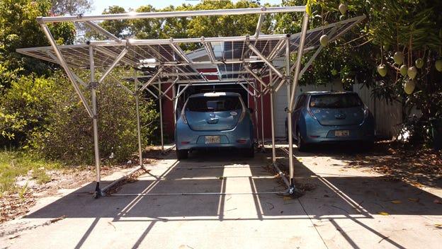 Car under GismoPower solar carport at the Ginsberg-Klemmt residence.