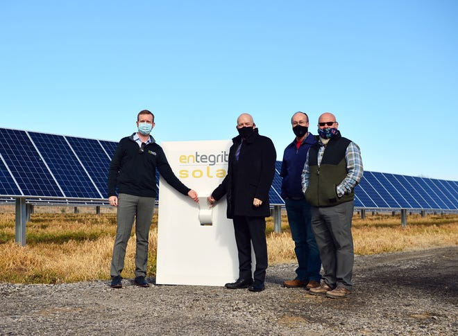 Entegrity's Sam Selig, left, is seen with Alma Mayor Jerry Martin, Alma Public Works Director Mark Yardley, and District 5 Justice of the Peace Raymond Harvey at the city's Flip the Switch event on Feb. 5. The event commemorated powering on Alma's new solar array. The city is on its way to completing its solar project after unforeseen issues.