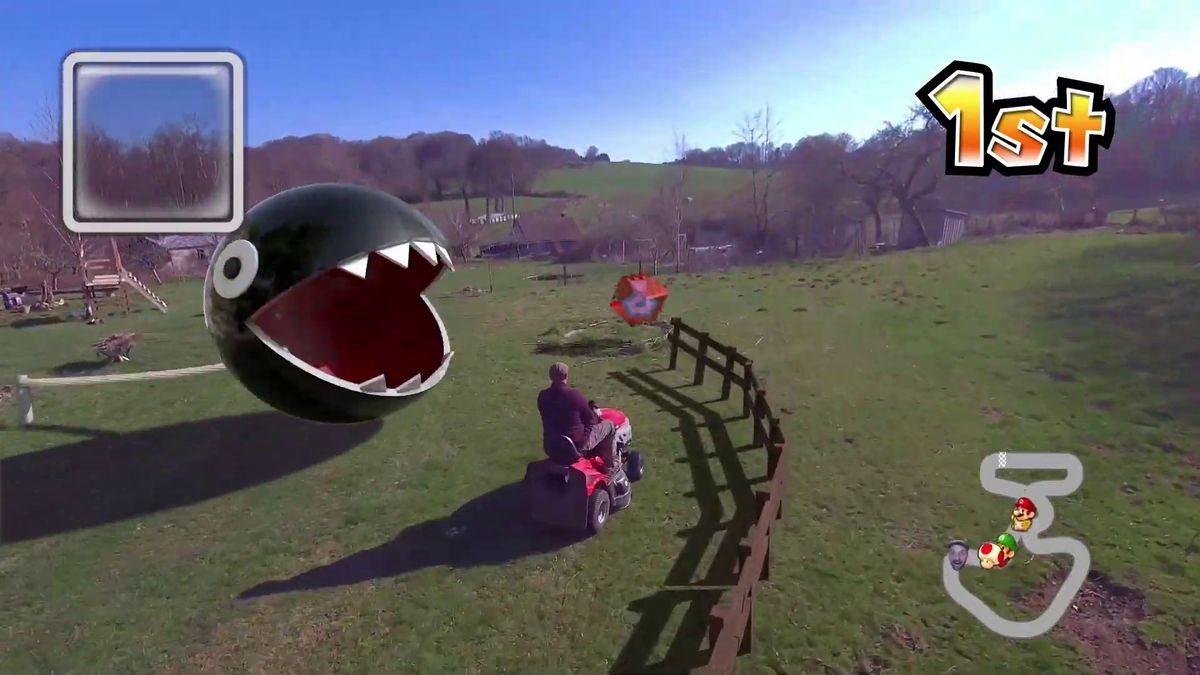 Mario Kart in real life thanks to CG and a self-flying drone: a chain chomp appears to be attacking this riding lawnmower.