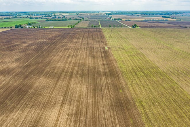 An aerial view of the roughly 2,000 acres of New Carlisle farmland that will be the site of a proposed solar farm and new tax-increment financing district linked with St. Joseph County's controversial Indiana Enterprise Center project on Wednesday, May 26, 2021, in New Carlisle, near Spruce Road.