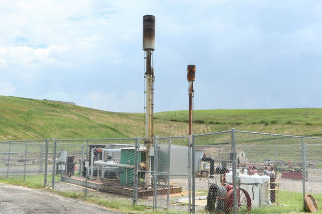 Natural gas collectors at the New Castle landfill in Delaware dispersing collected underground gasses safely into the air.