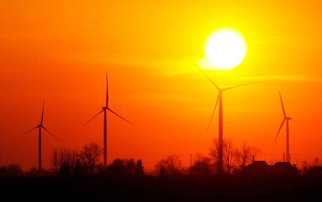 The sun sets over the Wildcat wind farm north of Elwood in this file photo. E.ON Climate and Renewables built the facility in Madison and Tipton counties. (The Herald Bulletin file photo)