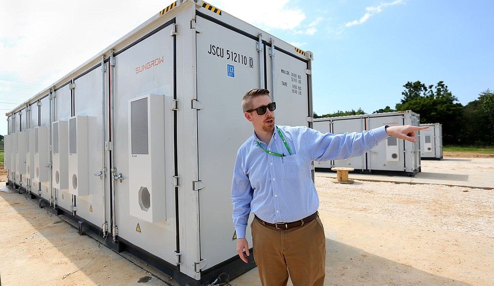 Todd Clouse, manager of Energy Services at Ozark Electric Cooperative, describes Wednesday, June 15, 2021, the battery storage units an control boxes at the new Solar Park being built by Ozark Electric Cooperative and Today's Power Inc. near Lincoln. The 25 acre park will service five entities with 2.7 megawatts of solar panels. Check out nwaonline.com/210620Daily/ and nwadg.com/photos for a photo gallery. (NWA Democrat-Gazette/David Gottschalk)