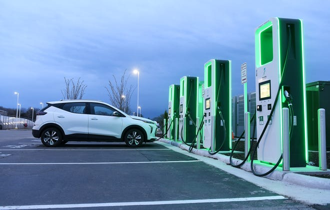 A vehicle charges at the Electrify America electric vehicle charging station at the Meijer store in Roseville, Mich. on April 19, 2021.