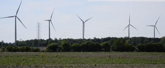 A row of wind turbines near Findlay, part of an Apex Clean Energy project.