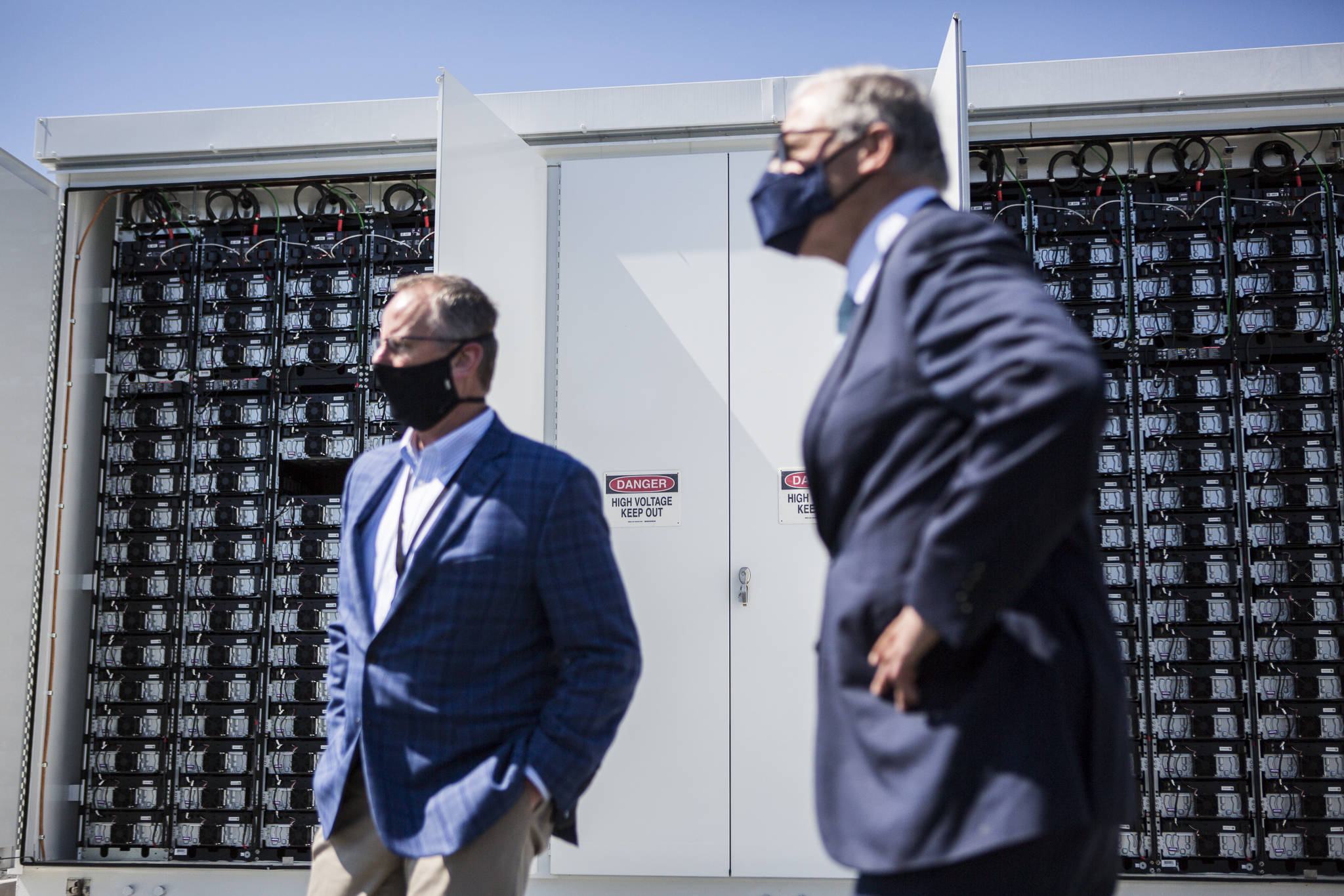 Snohomish County PUD's innovative microgrid batteries, which will store solar power, sit in their enclosed units during a visit by Gov. Jay Inslee. (Olivia Vanni / The Herald)