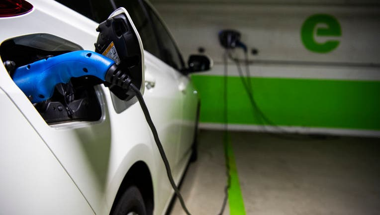FILE IMAGE - A Toyota Prius is seen connected to a electric vehicle charging station in a Washington, D.C., parking garage on March 31, 2021. (Photo By Tom Williams/CQ-Roll Call, Inc via Getty Images)