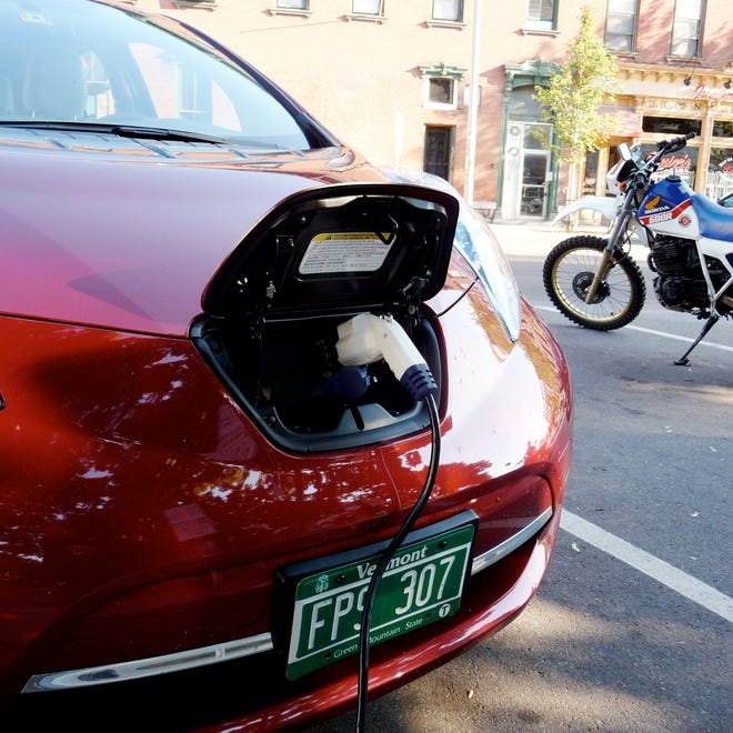 A Nissan Leaf electric car receives a top-up charge on Main Street in Burlington in mid-September, 2012.